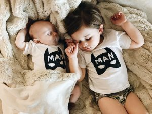 Sleeping brothers in matching Minted Method Batman outfits by Little Babe Designs