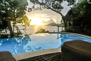 Beautiful sunset over the infinity pool at the Duavata villa at the Namale resort in Fiji