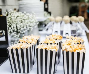Batman kids' birthday party decor; cake, popcorn, and cake pops