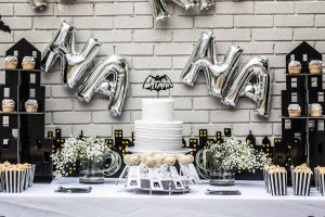 Batman kids' birthday party decor; cake, cupcakes, popcorn, and cake pops