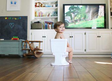 Potty training boy watching TV